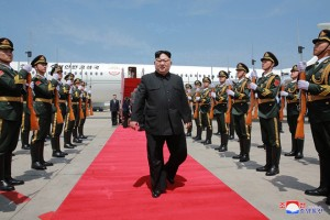 epa06720744 A photo released by the official North Korean Central News Agency (KCNA), the state news agency of North Korea, shows North Korean leader Kim Jong-un (C) arriving at the airport in Dalian, China, 08 May 2018 (issued 09 May 2018). Kim Jong Un is on an official visit to Dalian City in China from 07 to 08 May for a meeting with Chinese President Xi Jinping.  EPA/KCNA   EDITORIAL USE ONLY