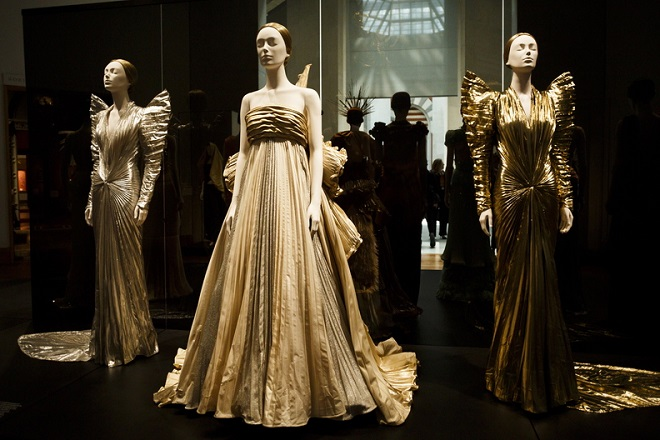 epa06717165 A view of designs on display as part of the Metropolitian Museum of Art Costume Institute's spring 2018 exhibition 'Heavenly Bodies: Fashion and the Catholic Imagination' in New York, New York, USA, 07 May 2018. The exhibit, which runs from 10 May until 10 October, features works by major designers inspired by the church as well as a number of papal robes and accessories on loan from the Vatican.  EPA/JUSTIN LANE