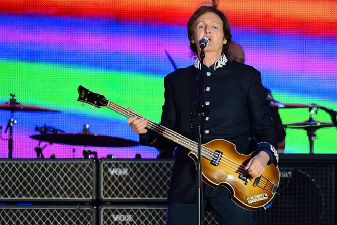 British singer Sir Paul McCartney performs during the Queen's Diamond Jubilee Concert at Buckingham Palace in London on Juine 4, 2012.  The star-studded musical extravaganza comes on the third of four days of celebrations to celebrate Queen Elizabeth II's 60 years on the throne.  AFP PHOTO / LEON NEAL        (Photo credit should read LEON NEAL/AFP/GettyImages)