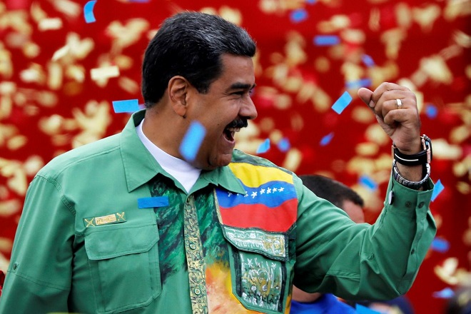 Venezuela's President Nicolas Maduro greets supporters during his closing campaign rally in Caracas, Venezuela May 17, 2018. REUTERS/Carlos Jasso
