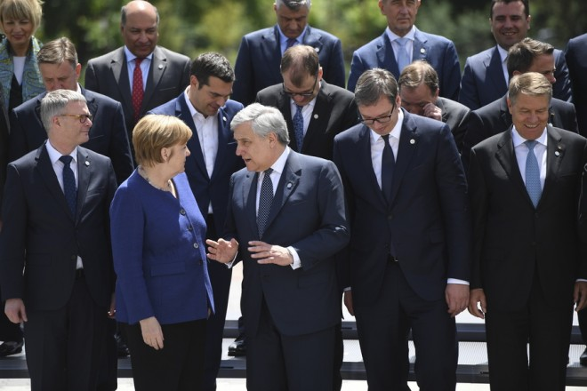 epaselect epa06744312 Germany's Chancellor Angela Merkel chats with President of the European Parliament, Antonio Tajani as European leaders pose for a family photo at an informal European Union (EU) summit with Western Balkans countries at the National Palace of Culture in Sofia, Bulgaria, 17 May 2018. EU leaders will discuss European future for Western Balkans, and the response to President Trump's policies on trade and Iran.  EPA/VASSIL DONEV / POOL