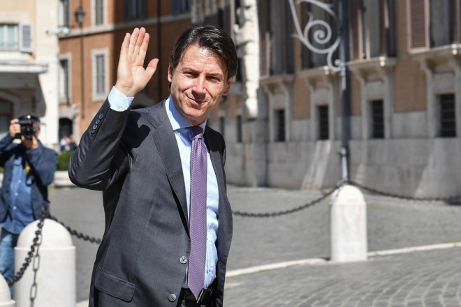 epa06759294 Designated Italian Prime Minister Giuseppe Conte waves as he arrives at the Lower House in Rome, Italy, 24 May 2018. Conte is holding a round of consultations with Italy's political parties at the Lower House on 24 May, after getting a mandate from President Sergio Mattarella on 23 May, to form a government.  EPA/ALESSANDRO DI MEO