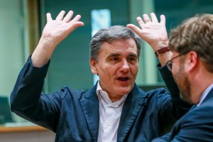 epa06760149 Greek Finance Minister Euclid Tsakalotos reacts as he waits for the start of an Eurogroup Finance Ministers' meeting at the European Council in Brussels, Belgium, 24 May 2018.  EPA/STEPHANIE LECOCQ
