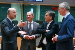 epa06760061 (L-R) Pierre Moscovici, the European Commissioner for Economic and Financial Affairs, Taxation and Customs, German Minister of Finance Olaf Scholz, Greek Finance Minister Euclid Tsakalotos and French Finance Minister Bruno Le Maire chat prior to the start of an Eurogroup Finance Ministers' meeting at the European Council in Brussels, Belgium, 24 May 2018.  EPA/STEPHANIE LECOCQ