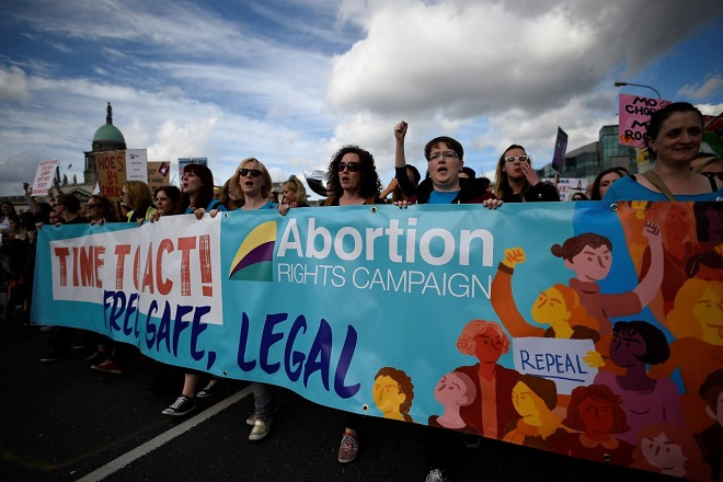 Demonstrators hold posters as they march for more liberal Irish abortion laws, in Dublin, Ireland September 30, 2017. REUTERS/Clodagh Kilcoyne