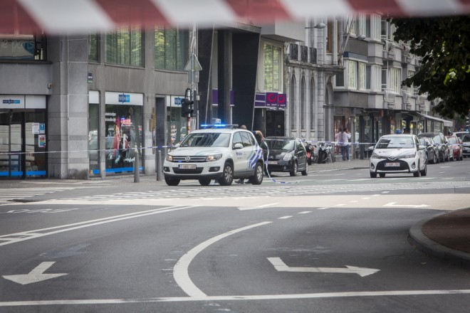 epa06770676 Police cars at the scene following a shooting in Liege, Belgium, 29 May 2018. According to media reports, a gunman was shot dead by anti-terrorist police after reportedly killing two police officers and a passerby and injuring two others in the center of the Belgian city of Liege on 29 May. During a shootout the man was said to have entered a high school where he took hostage a female cleaner before being shot by the police. Authorities are investigating the incident and terrorism was not ruled out as a possible motive.  EPA/MICHEL TONNEAU