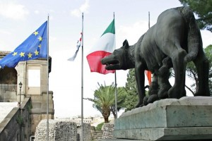 "The European and Italian flags wave behind Rome's symbol the ""She wolf"" on the Capitol place in Rome, 26 October 2004. The Capitol will host the Heads of State and Government and Foreign Ministers of 29 European countries next 29 October 2004 to participate at the ceremony of the signature of the Treaty and the Final Act wich establishes a Constitution for Europe.  AFP PHOTO / PATRICK HERTZOG / AFP PHOTO / PATRICK HERTZOG"