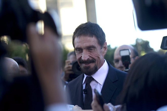 epa03496655 The millionaire creator of McAfee antivirus, John McAfee, arrives for a press conference in Guatemala City, on 4 December 2012. Reports state that McAfee, 67, who arrived in the country since 03 December 2012 and will claim political asylum, is considered 'a fugitive from the Government of Belize after being accused of allegedly murdering a neighbor.  EPA/SAUL MARTINEZ