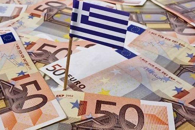 Bloomberg: H Αθήνα επιδιώκει μείωση του στόχου για το πρωτογενές πλεόνασμα