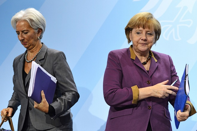 German Chancellor Angela Merkel (R) and Christine Lagarde, managing director of the International Monetary Fund (IMF), leave after a press conference following a meeting at the Chancellery in Berlin on October 30, 2012. Merkel hosted the meeting to discuss the global economy with the heads of the World Bank, IMF, the World Trade Organization and other top institutions.    AFP PHOTO / ODD ANDERSEN        (Photo credit should read ODD ANDERSEN/AFP/Getty Images)