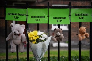 epaselect epa06806159 Tributes to victims of the Grenfell fire are displayed near the site of the tower bock in London, Britain, 14 June 2018 to mark the one year anniversary since the disaster took place. At least 71 people died in a fire that broke out at Grenfell Tower on 14 June 2017.  EPA/NEIL HALL
