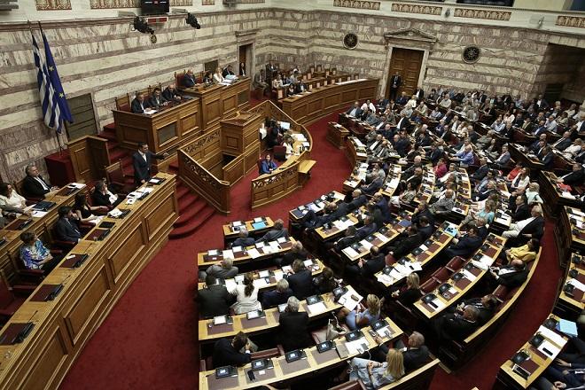 Ο πρωθυπουργός Αλέξης Τσίπρας μιλάει στη συζήτηση για τη ψήφιση του νομοσχεδίου με τα προαπαιτούμενα για το κλείσιμο της 4ης αξιολόγησης στην Ολομέλεια της Βουλής, Αθήνα, Πέμπτη 14 Ιουνίου 2018. ΑΠΕ-ΜΠΕ/ΑΠΕ-ΜΠΕ/ΣΥΜΕΛΑ ΠΑΝΤΖΑΡΤΖΗ