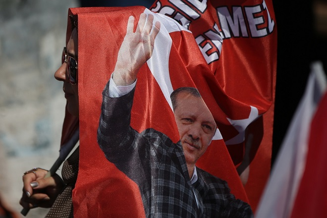epa06807272 Supporters of Turkish President Recep Tayyip Erdogan hold Turkish and AK Party flag during an election campaign rally  of Justice and Development Party (AK Party) in Yalova, Turkey, 14 June 2018. Turkish President Erdogan announced on 18 April 2018 that Turkey will hold snap elections on 24 June 2018. The presidential and parliamentary elections were scheduled to be held in November 2019, but government has decided the change the date following the recommendation of the Nationalist Movement Party (MHP) leader Devlet Bahceli.  EPA/ERDEM SAHIN