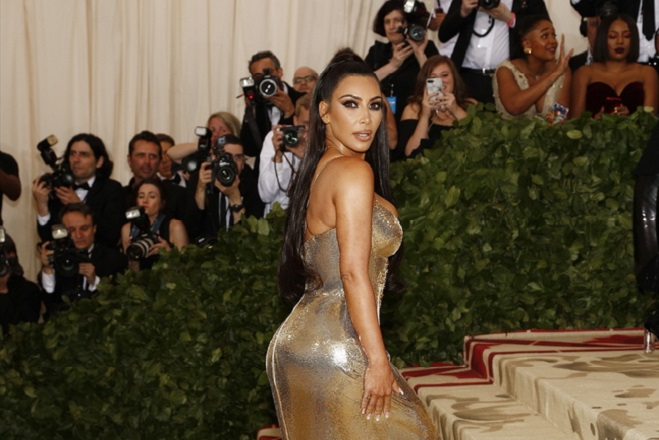 """epa06718131 Kim Kardashian arrives on the red carpet for the Metropolitan Museum of Art Costume Institute's benefit celebrating the opening of the exhibit """"Heavenly Bodies: Fashion and the Catholic Imagination"""" in New York, New York, USA, 07 May 2018. The exhibit will be on view at the Metropolitan Museum of Art's Costume Institute from 10 May to 08 October 2018.  EPA/JUSTIN LANE"""