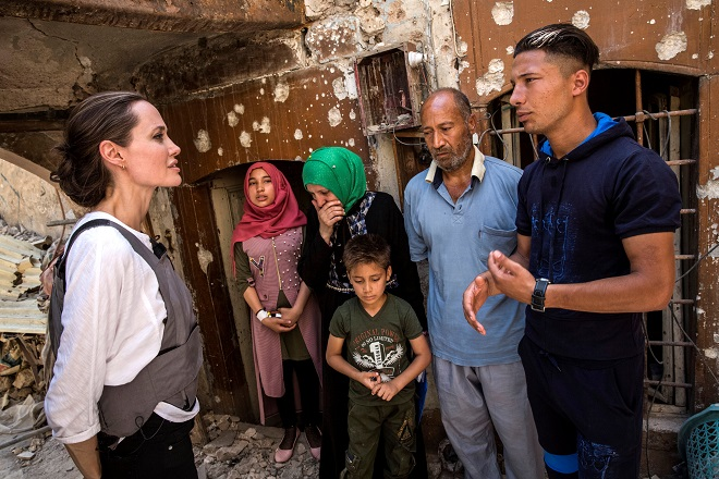 UNHCR Special Envoy Angelina Jolie meets with Mohamed and his family during a visit to the Old City in West Mosul, Iraq June 16, 2018. UNHCR/Andrew McConnell/Handout via REUTERS. THIS IMAGE HAS BEEN SUPPLIED BY A THIRD PARTY. REUTERS IS UNABLE TO INDEPENDENTLY VERIFY THE AUTHENTICITY, CONTENT, LOCATION OR DATE OF THIS IMAGE.