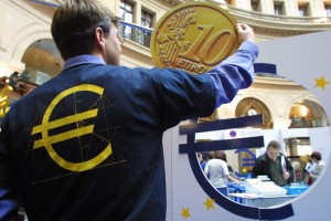 An unidentified man fixes a 10 euro coin copy, 14 May 2001, at the trade stock exchange in Paris, for the  euro fair opening seven months before the european currency introduction. EPA-AFP PHOTO THOMAS COEX