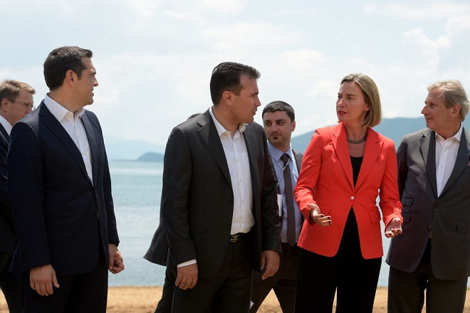 epa06815088 Greece Prime Minister Alexis Tsipras (L) with Macedonian Prime Minister Zoran Zaev (2-L) speak with EU members Frederica Mogerini (2-R) and EU enlargement commissioner Johannes Hahn (R), in Oteshevo  FYR of Macedonia, 17 June 2018. The foreign ministers of Greece and the Former Yugoslav Republic of Macedonia (FYROM), Nikos Kotzias and Nikola Dimitrov, and the UN Secretary General's Special Envoy for the name dispute signed a historic agreement on 17 June 2018 for resolving the decades-long issue during a lakeside signing ceremony in Prespes, where the borders of Greece, FYROM and Albania meet.  EPA/NAKE BATEV