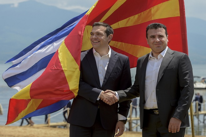 epa06815071 Greek Prime Minister Alexis Tsipras (L) and FYROM Prime Minister Zoran Zaev (R) shake hands after their arrival on Macedonian side of  the Lake Prespa, near Otesevo, the Former Yugoslav Republic of Macedonia (FYROM), 17 June 2018. Prime Ministers from Greece and Macedonia meet in the Prespes lake district, that borders both countries, and sign an agreement aimed at ending a decades-long dispute between their countries. The agreement shall lead to the renaming of Greece's northern neighbour, as well as its EU and NATO entry.  EPA/NAKE BATEV