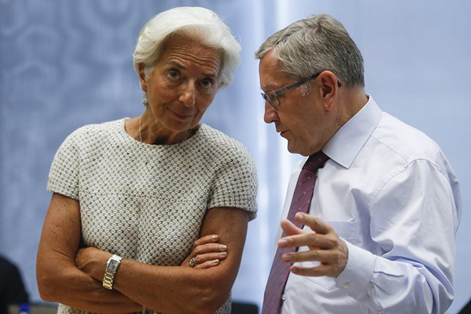 epa04842311 International Monetary Fund managing director Christine Lagarde (L) chats with  Managing Director of European Financial Stability Facility (EFSF), German Klaus Regling at the start of a special Eurogroup meeting on Greece, at European Council headquarters in Brussels, Belgium, 11 July 2015. Eurozone finance ministers were set to evaluate Greece's request for a new bailout package, with diplomats saying that the chances of a deal stand at 50-50. Athens is teetering on the edge of bankruptcy, cut off from bailout aid, in arrears to the International Monetary Fund (IMF), owing large debt repayments this month and fending off suggestions that it may soon have to exit the eurozone.  EPA/OLIVIER HOSLET