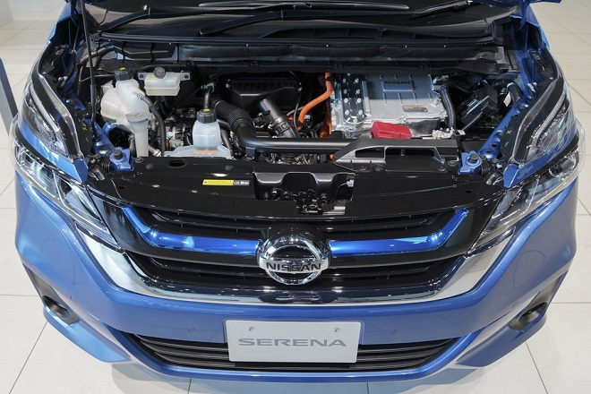 epa06569601 The engine bay of Nissan Serena e-POWER hybrid minivan is shown on display during a launch event at Nissan Motor Company Ltd.'s global headquarters showroom in Yokohama, south of Tokyo, Japan, 28 February 2018. The Nissan Serena e-POWER is the successor to the already popular Serena minivan, now equipped with an innovative electrified powertrain that delivers superior driving performance, and fuel efficiency. The Serena e-POWER will go on sale in Japan on 01 March.  EPA/CHRISTOPHER JUE