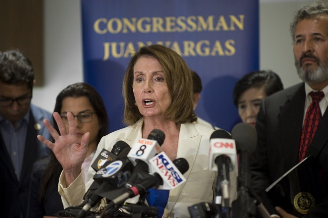 epa06819948 US Congresswoman, House Minority Leader Nancy Pelosi (D-CA) speaks to reporters during a press conference at the Cross Border Xpress airline terminal in San Diego, California, USA, on 18 June 2018. A group of 14 US congress members led by Pelosi was in San Diego to visit several immigration detention centers and to address the issue of family separation and President Trumps zero tolerance policy toward undocumented immigration.  EPA/David Maung