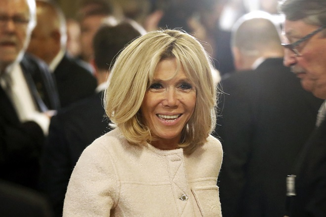 epa06724565 The wife of French President Emmanuel Macron, Brigitte Macron, smiles as she attends the mess part of the Charlemagne Prize (Karlspreis) ceremony at the Cathedral in Aachen, Germany, 10 May 2018. Macron was named to receive the prestigious Charlemagne Prize on 10 May 2018. Annually since 1950, the 'Karlspreis' has been awarded to people who contributed to the unity of Europe and is given by the German city of Aachen.  EPA/FRIEDEMANN VOGEL