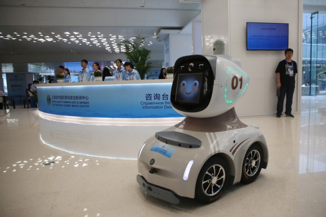 epa06795680 A robot is seen at the media center for the Shanghai Cooperation Organization Summit ahead the 18th Shanghai Cooperation Organization (SCO) Summit in Qingdao city, Shandong province, China, 09 June 2018. The 18th Shanghai Cooperation Organization Summit will be held in Qingdao from 09 to 10 June 2018.  EPA/WU HONG