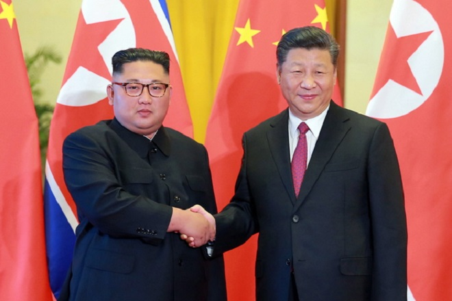 epa06823086 A photo released by the official North Korean Central News Agency (KCNA) shows North Korean leader Kim Jong-un (L) shaking hands with Chinese President Xi Jinping (R) during a state dinner at the Great Hall of the People in Beijing, China, 19 June 2018. Kim Jong Un, chairman of the Workers' Party of Korea and chairman of the State Affairs Commission of the Democratic People's Republic of Korea, is visiting the People's Republic of China from 19 to 20 June.  EPA/KCNA   EDITORIAL USE ONLY