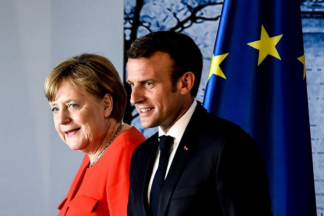 epa06821677 German Chancellor Angela Merkel (L) and French President Emmanuel Macron after a press conference during the German-French Minister Meeting at German government's guest house Meseberg Palace in Meseberg, near Berlin, Germany, 19 June 2018. German and French ministers meet for a one day meeting to discuss bilateral topics, including Foreign, Defence and Security politics.  EPA/FILIP SINGER