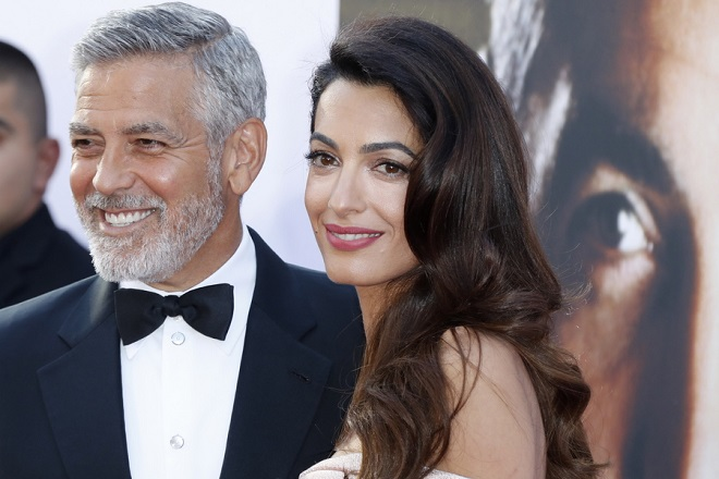 epa06792472 US actor George Clooney (L) and his wife Amal Clooney (R) arrive for the American Film Institute 46th Life Achievement Award Gala at the The Dolby Theatre in Hollywood, California, USA, 07 June 2018. The American Film Institute honored George Clooney for his acting, writing, directing and producing of films that advance the art of film and whose work has stood the test of time.  EPA/PAUL BUCK