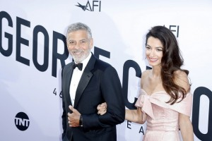 epaselect epa06792470 US actor George Clooney (L) and his wife Amal Clooney (R) arrive for the American Film Institute 46th Life Achievement Award Gala at the The Dolby Theatre in Hollywood, California, USA, 07 June 2018. The American Film Institute honored George Clooney for his acting, writing, directing and producing of films that advance the art of film and whose work has stood the test of time.  EPA/PAUL BUCK