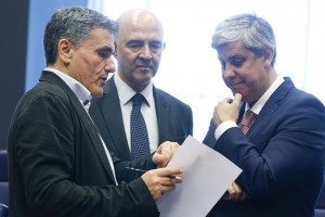 epa06827534 (L-R) Greek Finance Minister Euclid Tsakalotos,  European Commissioner for Economic and Financial Affairs, Pierre Moscovici and The President of the Eurogroup, Portuguese Finance Minister Mario Centeno during a meeting of the Eurogroup in Luxembourg, 21 June 2018. The Eurogroup will assess the progress achieved by Greece in implementing the prior actions required under the fourth (and the final) review of its programme.  EPA/JULIEN WARNAND