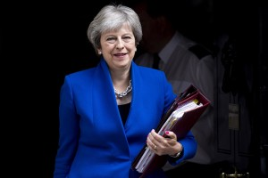 epa06823714 British Prime Minister Theresa May leaves Downing Street, in central London, Britain, 20 June 2018 to attend Prime Minister Questions (PMQs) in the House of Commons. A further hearing and vote on the governments EU Withdrawal Bill is due to take place later 20 June 2018 in the House of Commons, where Members of the Parliament will vote on whether they will get a future vote on Britain's future relationship with the European Union (EU).  EPA/WILL OLIVER