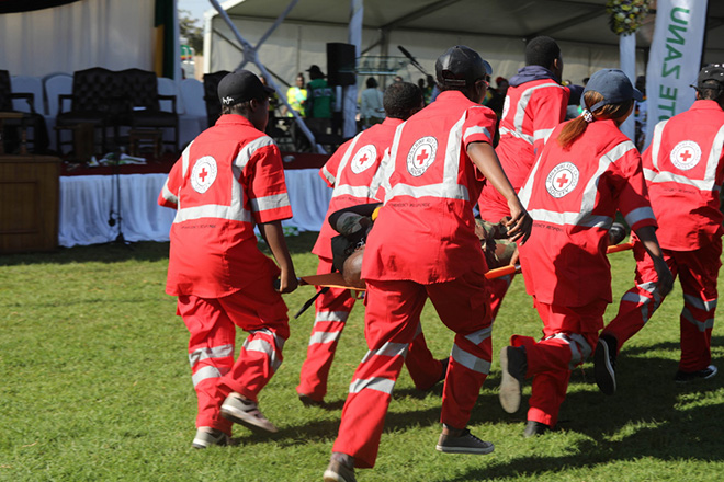 epa06833644 Members of the Zimbabwe Red Cross Society (ZRCS) carry an injured member of the Zimbabwe National Army (ZNA), who was reportedly injured after a bomb went off at a rally addressed by President Emmerson Mnangagwa, at White City Stadium in Bulawayo, Zimbabwe, 23 June 2018. According to media reports, an apparent bomb attack rocked Zimbabwean President Emmerson Mnangagwa's election rally on 23 June in Bulawayo. The incident left multiple people injured, media added. 'The president was evacuated successfully,' his spokesman said.  EPA/STRINGER