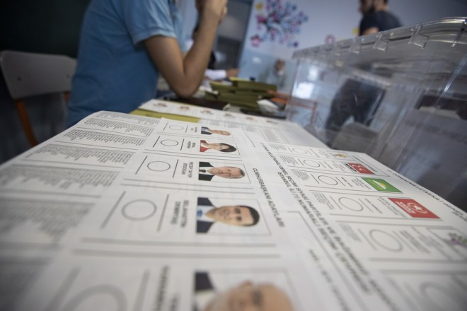 epa06835359 Ballots with pictures of Presidential candidates are displayed as Turkish people cast their vote for the Turkish presidential and parliamentary elections in Istanbul, Turkey, 24 June 2018. 56.3 million registered citizens will vote in snap presidential and parliamentary elections to elect 600 lawmakers and the country's president, the first election since the Turkish people in a referendum in April 2017 voted to change the country's system from a parliamentary to a presidential republic.  EPA/SEDAT SUNA