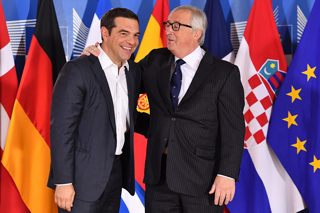 epa06836281 European Commission President Jean-Claude Juncker (R) welcomes Greek Prime Minister Alexis Tsipras (L) at the informal meeting on migration and asylum issues in Brussels, Belgium, 24 June 2018. European Commission President Jean-Claude Juncker hosts the gathering ahead of a full summit of all 28 European Union leaders to overhaul the EU asylum system on June 28.  EPA/Geert Vanden Wijngaert / POOL