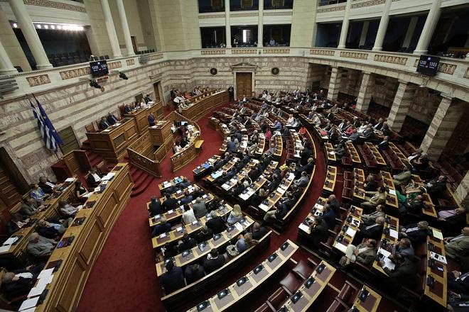 Ο πρόεδρος της ΝΔ Κυριάκος Μητσοτάκης μιλάει στη συζήτηση για την ψήφιση του νομοσχεδίου με τα προαπαιτούμενα για το κλείσιμο της 4ης αξιολόγησης στην Ολομέλεια της Βουλής, Αθήνα, Πέμπτη 14 Ιουνίου 2018. ΑΠΕ-ΜΠΕ/ΑΠΕ-ΜΠΕ/ΣΥΜΕΛΑ ΠΑΝΤΖΑΡΤΖΗ