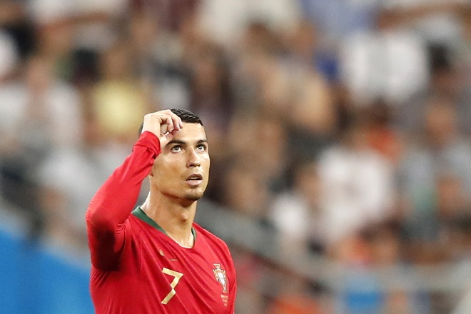 epa06840165 Cristiano Ronaldo of Portugal reacts during the FIFA World Cup 2018 group B preliminary round soccer match between Iran and Portugal in Saransk, Russia, 25 June 2018.  (RESTRICTIONS APPLY: Editorial Use Only, not used in association with any commercial entity - Images must not be used in any form of alert service or push service of any kind including via mobile alert services, downloads to mobile devices or MMS messaging - Images must appear as still images and must not emulate match action video footage - No alteration is made to, and no text or image is superimposed over, any published image which: (a) intentionally obscures or removes a sponsor identification image; or (b) adds or overlays the commercial identification of any third party which is not officially associated with the FIFA World Cup)  EPA/RUNGROJ YONGRIT   EDITORIAL USE ONLY