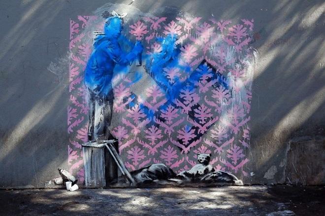 Paris Migrants Banksy AP