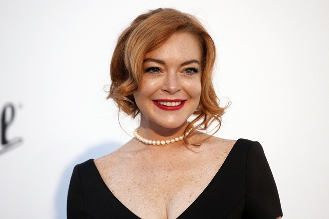 epa05990290 US actress Lindsay Lohan attends the Cinema Against AIDS amfAR gala 2017 held at the Hotel du Cap, Eden Roc in Cap d'Antibes, France, 25 May 2017, within the scope of the 70th annual Cannes Film Festival that runs from 17 to 28 May.  EPA/GUILLAUME HORCAJUELO