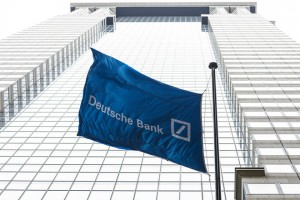 epa06775740 A flag hangs in front of the Deutsche Bank offices on Wall Street in New York, New York, USA, 31 May 2018. The United States Federal Reserve reportedly designated the bank's operations in the US as in 'troubled condition' last year, one of the lowest ratings used by the Fed, but the news was reported today.  EPA/JUSTIN LANE