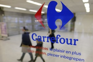 epa06570546 (FILE) - Closed gates of the Carrefour Supermarket are seen behind a company logo in a galss door of the company's headquarters in the Evere district of Brussels, Belgium, 25 January 2018. Carrefour, second largest retailer in the world by sales releases results, is to release their 2017 full year results on 28 February 2018 after market close.  EPA/OLIVIER HOSLET