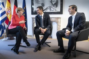 epa06849321 A handout photo made available by the German Government shows German Chancellor Angela Merkel (L) talking with Spanish Prime Minister Pedro Sanchez (C) and Greek Prime Minister Alexis Tsipras on the sidelines of the second day of an European Council summit in Brussels, Belgium, 29 June 2018. EU countries' leaders met on 28 and 29 June for a summit to discuss migration, the installation of asylum-seeker processing centers in northern Africa, and other security and economy related topics including Brexit.  EPA/GUIDO BERGMANN / GERMAN GOVERNMENT HANDOUT  HANDOUT EDITORIAL USE ONLY/NO SALES