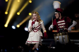 epa03280375 US singer Madonna performs on stage during a concert of her MDNA 2012 World Tour concert, in Coimbra, Portugal, 24 June 2012.  EPA/PAULO NOVAIS