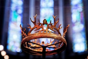 epa03706008 The crown from the epic 'Game of Thrones' series is seen in front of colorful windows during an exhibition about the US fantasy television series, at the Posthoornkerk in Amsterdam, Netherlands, 18 May 2013. The exhibition showing weapons, costumes and props from the TV series will be open to the public on 19 and 20 May as well as from 25 to 27 May.  EPA/ROBIN UTRECHT
