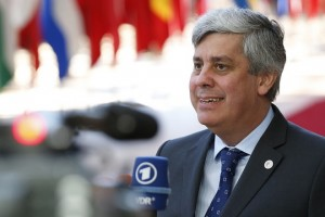 epa06849395 The President of the Eurogroup, Portuguese Finance Minister Mario Centeno speaks to the media as he arrives for the European Council summit in Brussels, Belgium, 29 June 2018. The Twenty-Eight leaders of the European Union reached an agreement on the migratory issue at the end of the night, Friday, June 29 around 4:30, announced the President of the Council European Donald Tusk.  EPA/JULIEN WARNAND
