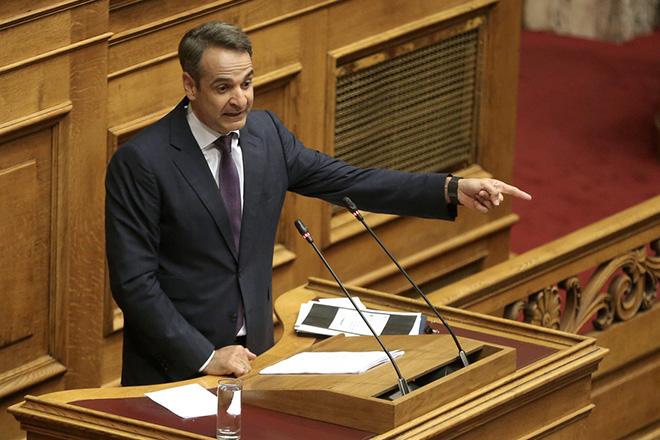 Ο πρόεδρος της ΝΔ Κυριάκος Μητσοτάκης μιλάει στην Ολομέλεια της Βουλής στη συζήτηση προ Ημερησίας Διατάξεως, με πρωτοβουλία του αρχηγού της αξιωματικής αντιπολίτευσης και προέδρου της Νέας Δημοκρατίας Κυριάκου Μητσοτάκη, σε επίπεδο αρχηγών κομμάτων, με θέμα την Οικονομία, τις αποφάσεις του Eurogroup και τις  δεσμεύσεις  που ανέλαβε η κυβέρνηση, Αθήνα, Πέμπτη 05 Ιουλίου 2018. . ΑΠΕ-ΜΠΕ/ΑΠΕ-ΜΠΕ/ΣΥΜΕΛΑ ΠΑΝΤΖΑΡΤΖΗ