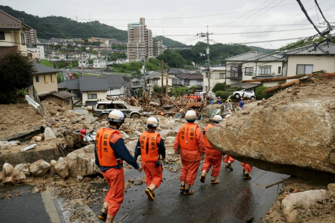 epa06873713 Hiroshima fire department rescue workers are searching missing people at landslide-devastated residential area in Hiroshima, Hiroshima Prefecture, western Japan, 08 July 2018. Heavy rainfall killed 81 people and missing 58 people at least in southwestern and western Japan, public television reported on 08 July 2018. Japan Meteorological Agency has warned record rainfall on 06 July for flooding, mudslides in southwestern and western Japan through 08 July and issued emergency weather warnings to six prefectures. In nine prefectures in western and southwestern Japan,  authorities issued evacuation orders to more than for million of people in southwestern and western Japan.  EPA/JIJI PRESS JAPAN OUT  EDITORIAL USE ONLY/NO SALES