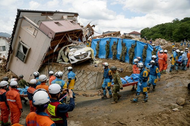 epa06874756 Police and Ground Self-Defense Force's rescue workers carry a victim away after they were killed by a landslide caused by heavy rains in Kumano, Hiroshima Prefecture, Japan, 09 July 2018. Heavy rainfall has left 112 people dead and at least 78 people missing in southwestern and western Japan, according to local television reports on 09 July. Japan Meteorological Agency has warned record rainfall on 06 July may cause flooding and mudslides in parts of Japan through to 08 July. Local authorities have issued emergency weather warnings and have sent out evacuation orders to more than 3.8 million people.  EPA/JIJI PRESS EDITORIAL USE ONLY/NO ARCHIVE/JAPAN OUT  EDITORIAL USE ONLY/NO SALES/NO ARCHIVES