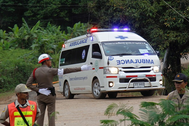 epa06877892 A Royal Thai police ambulance evacuates a cave trapped boy to hospital after he was rescued from the Tham Luang cave, Khun Nam Nang Non Forest Park in Chiang Rai province, Thailand, 10 July 2018. According to reports, all 12 boys of a child soccer team and their assistant coach have been rescued and evacuated to a hospital, 13 members of a youth soccer team including their assistant coach have been trapped in Tham Luang cave since 23 June 2018.  EPA/PONGMANAT TASIRI